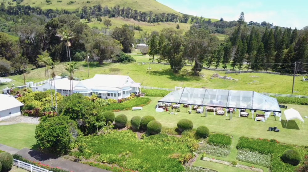 Ariel view of our Clear Tent set up with Farm Tables and Round tables at Anna's Ranch in Waimea.