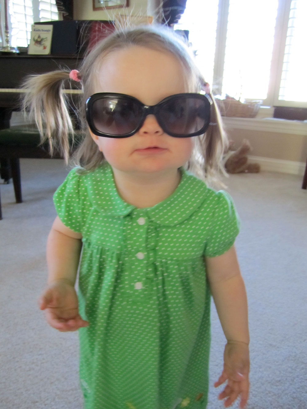 Gigi wearing her mom's sunglasses.