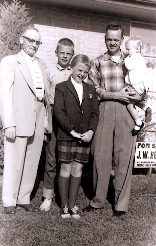 Woody (center back) with his father, grandfather, and two sisters