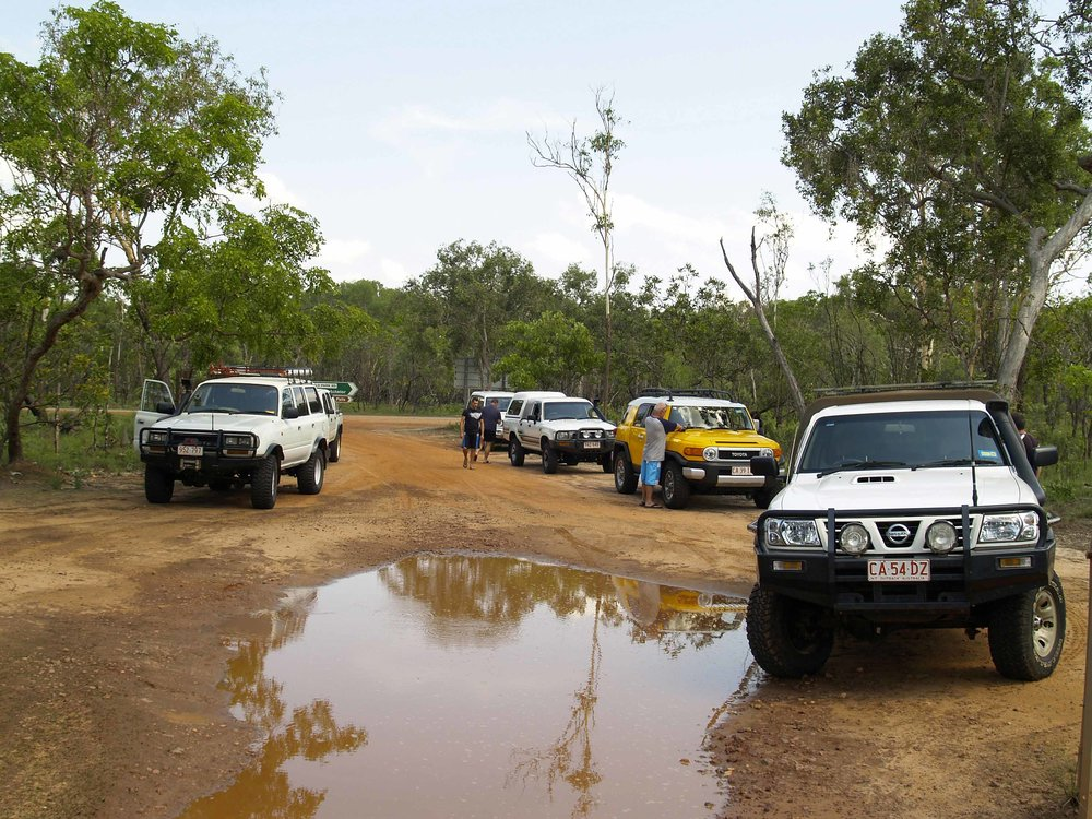 The turn-off to Reynolds River is located between those to Tolmer and Wangi Falls.