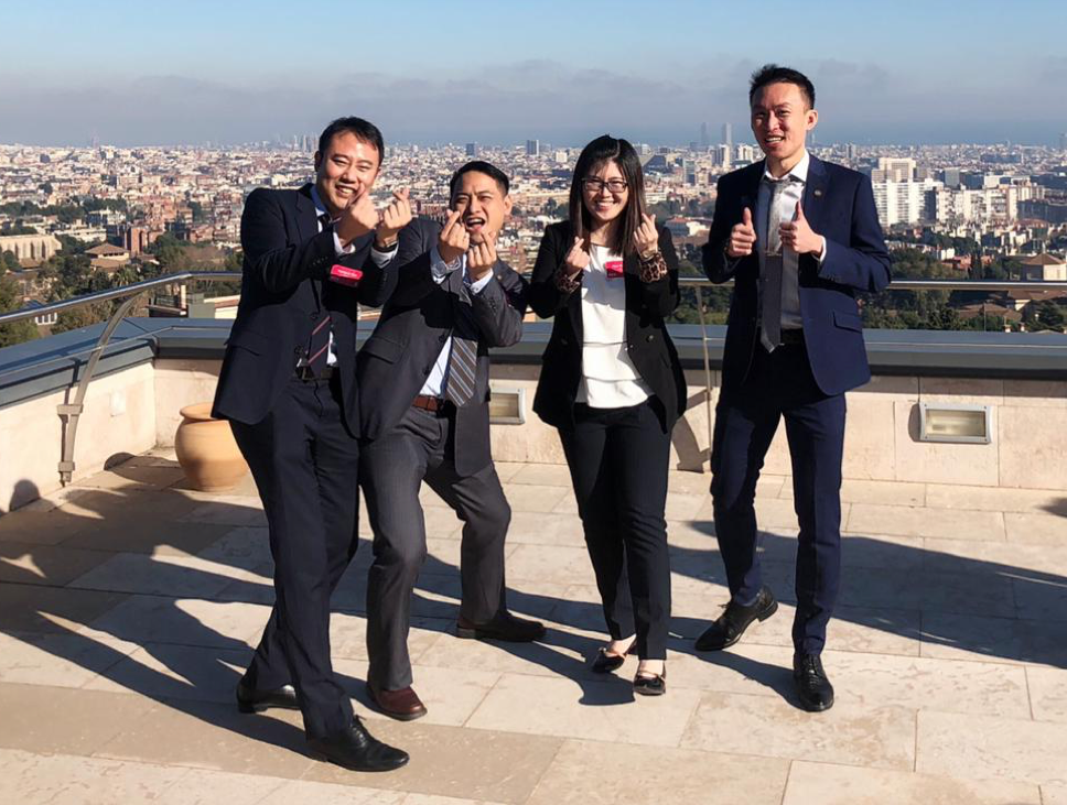 Team HKUST on top of IESE Business School Building (mostly) giving out hearts