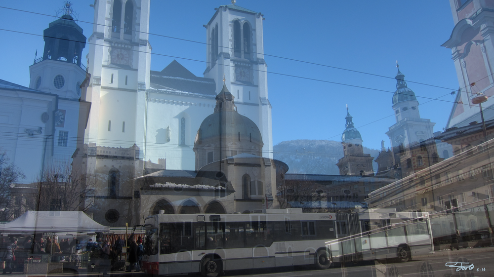 """  Kirche St. Andra  ."" - Photo Overlay. Salzburg. 2016.    ""Kirche St. Andra is a rather modern church by Austrian standards, but it's still an interesting structure on the Mirabellplatz.  I find that the trolleybus serves as a nice contrast, especially with the wires creating a flow.  The farmers market is in full swing on the left and the mountains can be seen in the background."""
