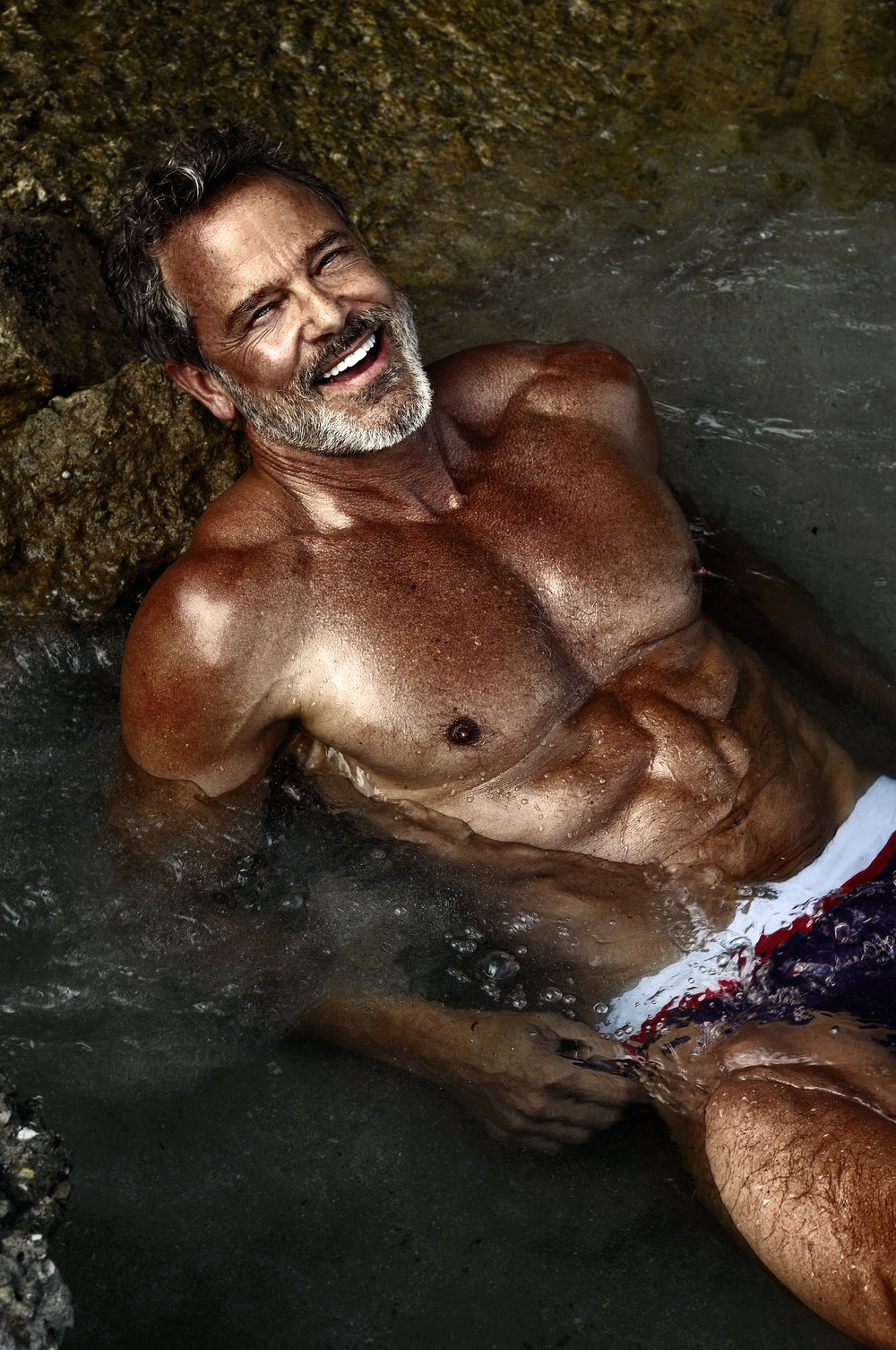 """Tom Ernsting  Profession: Model Instagram Account: @tomdeanernsting Website or social media link: https://tomernsting.com Email address: Tom.ernsting@icloud.com Florida, USA  About: I never thought I would be living my """"best life"""" after 50....let alone at 58. When I was planning my """"retirement from corporate life friends suggested following your passions! I've been lucky to incorporate my love for travel and hotels in a 2nd career in freelance event management and my fitness passion for a shared 2nd career modelling. And having the best time keeping engaged and relevant and learning.   Your Story Seven years Ago I started the first of three shoulder Surgeries. The ensuing years were dominated by chronic pain, physical therapy, and withdrawing from society due to the distraction of the pain. My body atrophied, and depression took over. It was only after I quit my job and left NYC (after 15 years) for Naples to start my """"second careers"""" did my world return and life exploded (in a perfect way)   Photo Credits: Scott Tatlier  Ron Reagan  Anna Zee"""