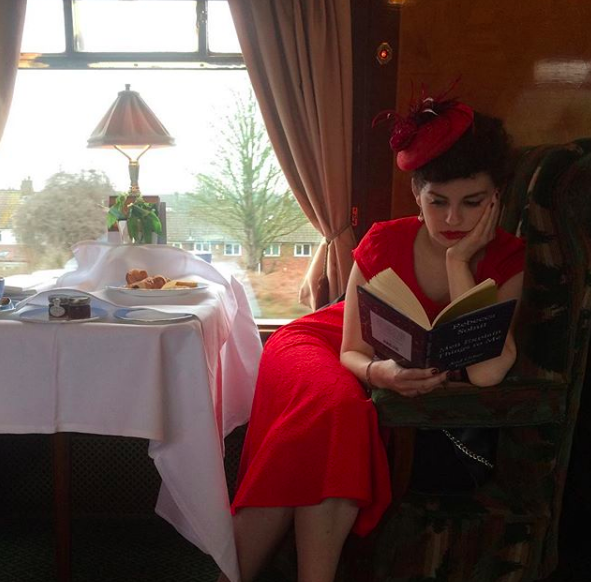 Reading on the job - taking a break in between sets onboard the Belmond British Pullman.