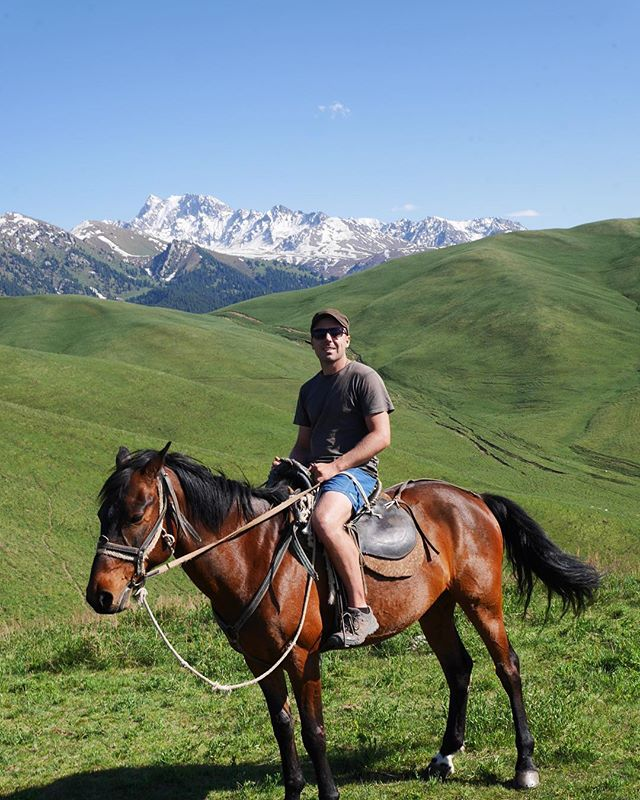 A trip to Kyrgyzstan isn't complete without a horse ride, so we rented a couple for the day and went off exploring. The mountains of Kyrgyzstan are home to nomads, and it was awesome to get away from the roads to see the hills dotted with yurts and nomads at work.  #nomad #kyrgyzstan #silkroad #horsesofinstagram #tienshan #mountains