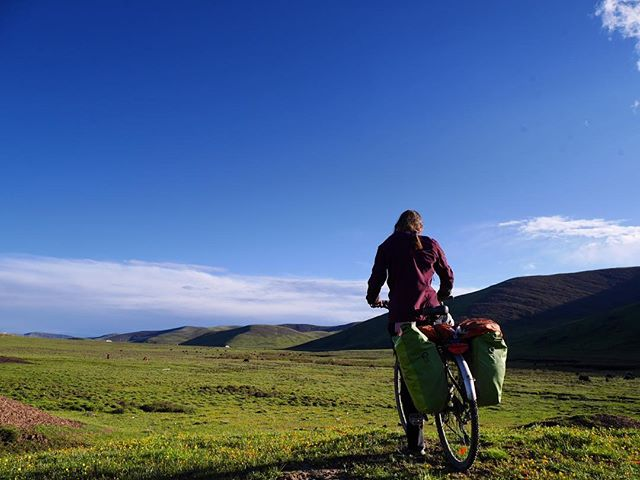 Manon enjoying the beautiful landscape in the late afternoon sun on the Tibetan plateau. We've spent the last week cruising around 3500m, sharing bread with Tibetan pilgrims and stumbling upon summer horse festivals - loving the last few weeks of our trip. . . . . . . . . . #bikewander #worldbybike #cyclinglife #bikelife #pedalforever #bicycletouring #tibet #tibetanplateau #picoftheday #getoutside #neverstopexploring