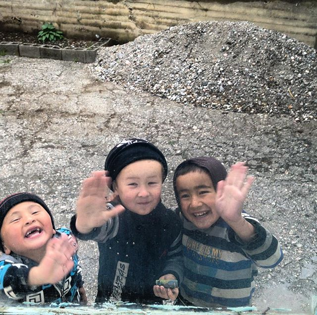 There's no better sight while cycling than the local kids running out to say hello. No matter how tired you are, it always puts a smile on your face when you see their grins. These guys were hanging outside the window of our guesthouse in Arslanbob, Kyrgyzstan. #worldbybike #bikewander #silkroad #kyrgyzstan #smile