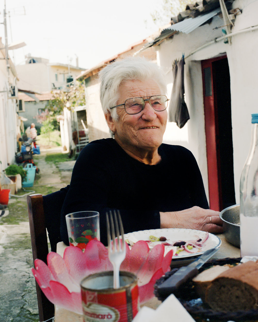 ANASTASIA   LIVES: Perivoli, Corfu, Greece  BORN: 1934, Corfu  MOTHER TONGUE: Greek  GRANDCHILDREN: Hippocrates, Ellie, Anastasia,Tasia, George, Gregori  THEY CALL HER: Yiayia  COOKING:  Marinated Sea Bream + Skordalia Dip