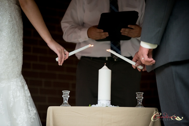 The unity candle is a tradition some couples use at their wedding ceremony.  A joining of two flames.