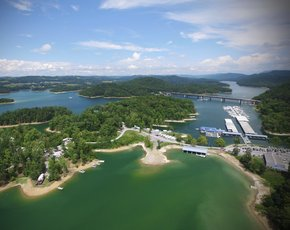 Beach Island Resort and Marina  Beach Island Resort and Marina 170 Beach Island Road Maynardville, TN 37807 Tel: (865) 992-3091 Beach Island Resort and Marina can cater to all of your Norris Lake vacation and recreation needs. We offer 7-bedroom, 80-foot luxury houseboat rentals, as well as pontoon and ski boat rentals. Full-hookup RV sites, secluded cabins, and up to 100-foot boat slips are available and just a short walk to the marina and Bubba Brew's Sports Pub and Grill. The dock store offers beer, ice, snacks, and ethenol-free fuel. Beach Island Fitness offers a 24-hour state of the art fitness facility overlooking Norris Lake. We are located 25 miles North of Knoxville at the HWY 33 Bridge.     beachislandmarina.com