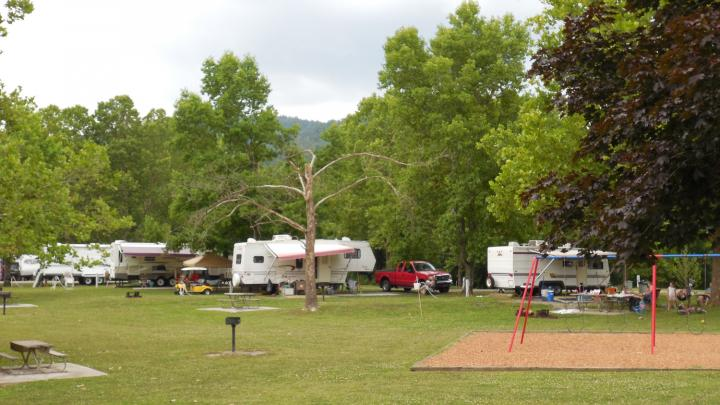 Indian Mountain Campground, Indian Mountain State Park Rates: $31.25Taxes and fees are not included. Rates subject to change. $5 reservation fee per site is non-refundable. Indian Mountain is a popular camping park. There are 47 sites with paved pads to serve both tent and RV campers. The sites have water, electricity with 30-amp breakers and a dump station. All sites have picnic tables and grills which are located throughout the camping area. A modern bathhouse with restrooms and showers is available to campers. Indian Mountain's campground is open year-round. The campground is winterized (all water including bath-house is turned off) from November 1 - March 31. http://tnstateparks.com/parks/campground/indian-mountain