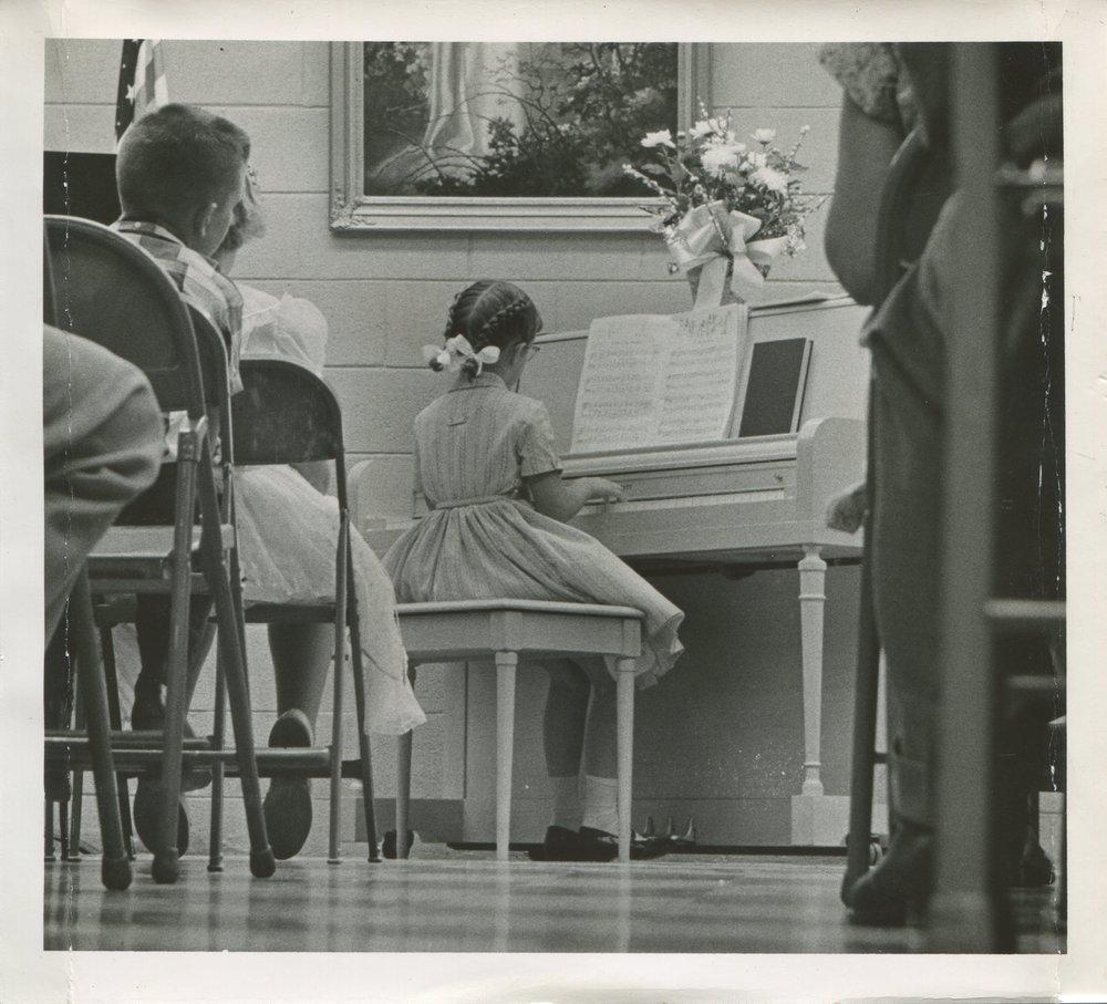 Mama playin' piano at church as a girl