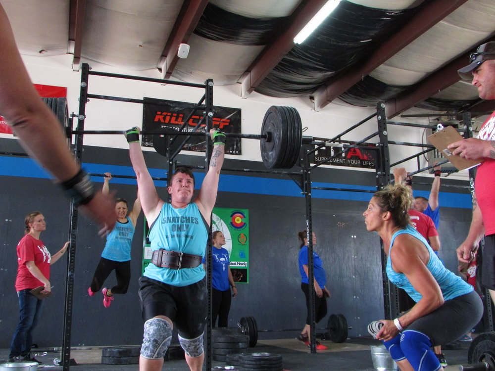 I love all of our faces in this one! Sheri in the back working those chest to bars, Ashlee working her 180lb pr, and me somehow transferring some power to Ashlee! Even our judge is grunting! haha!
