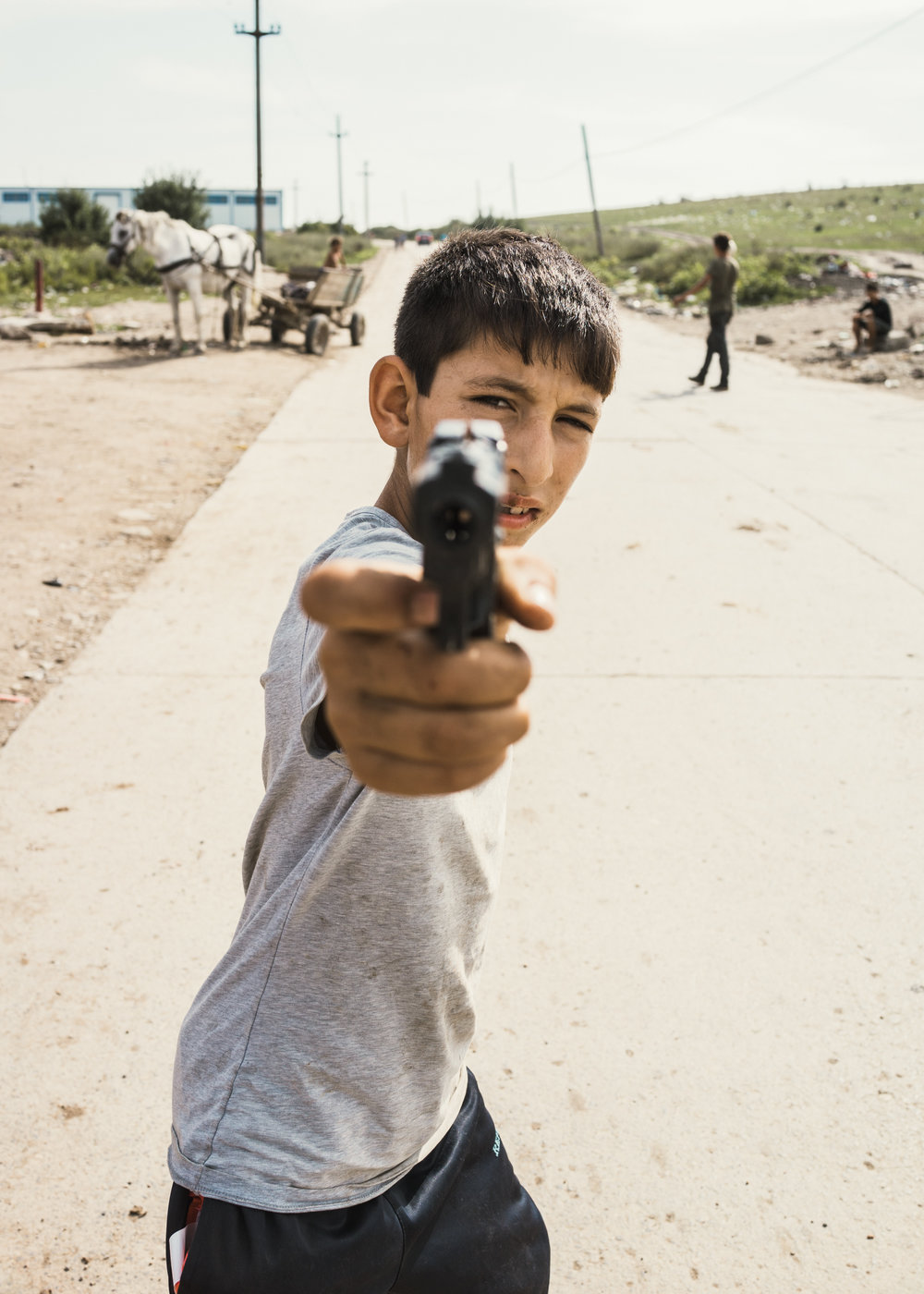 Transylvania #3.   Boy with gun, Pata Rat, 2014