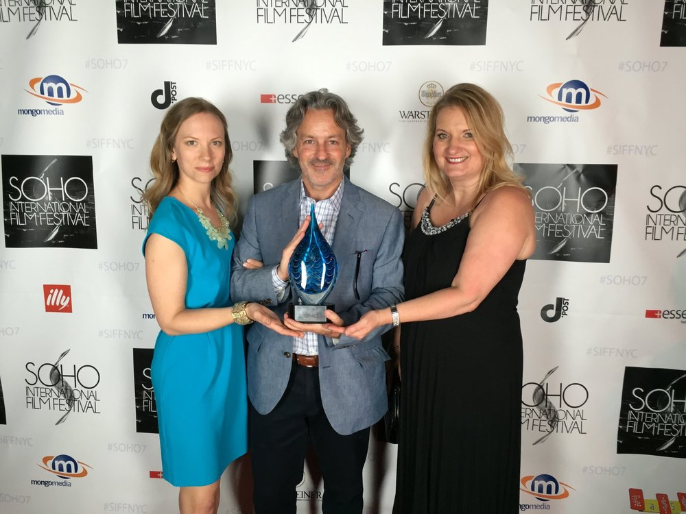 "Accepting the Audience choice award for BEST FEATURE at the Soho International Film Festival for ""79 Parts"", with producer John Overend and Casting director Donna McKenna."
