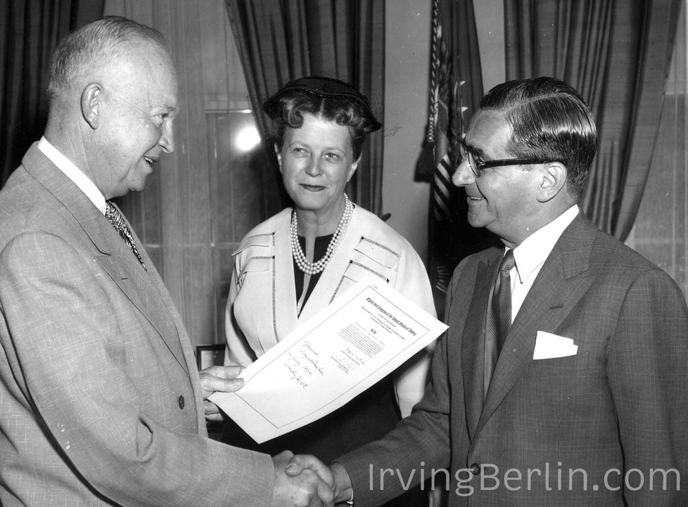 Irving Berlin, pictured with his wife Ellin, receiving a Congressional Gold Medal from President Eisenhower.