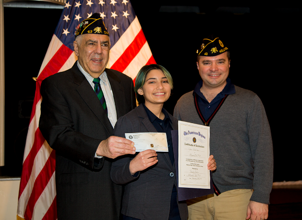 Cyan Jackson receives her winning certificate and prize from Randy Kahn and First Vice Commander,  Fernando Rivero.