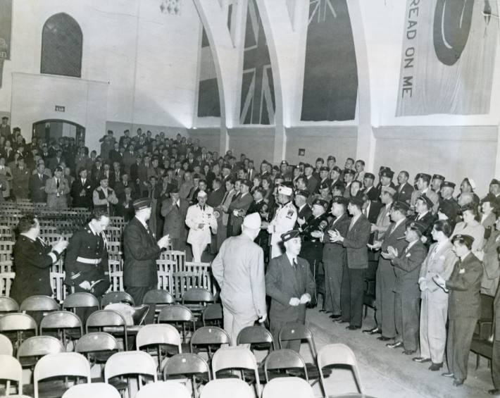 A new member induction ceremony in the post auditorium in the 1940s.