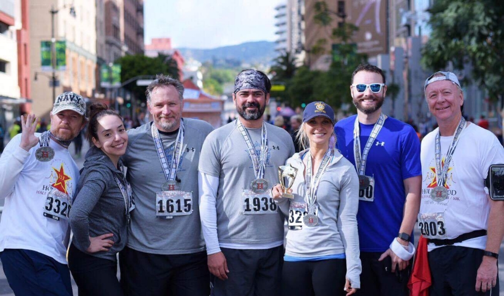 Congratulations to our Post 43 Running Team for finishing the 2017 Hollywood Half Marathon/10K/5K! This is the fourth year the Sports Committee sponsors runners from the post to participate in this great race right in our community.  From L ro R: Matt Skomo, Fernanda Miranda, Karl Risinger, Jeric Wilhelmsen, Jennifer Campbell, Mark Harper, Pat Birman  (photo by Shannon Corbeil)