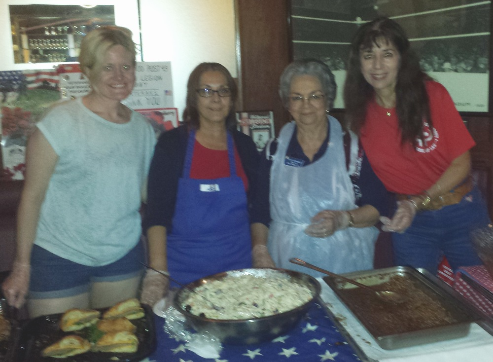 L to R:  Tamra Brown, Elisa Corral, Dahlia Hernandez, and Trish Blanton, along with others from our dedicated Auxiliary Unit 43 working back in the kitchen, did a superb job of feeding the hordes of hungry attendees crowded in the Art Deco Bar after our Memorial Day service.    (photo by Randy Kahn)