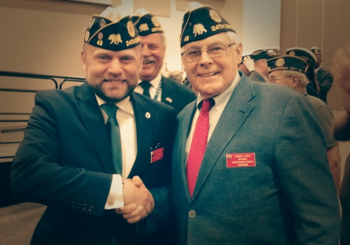 Michael Hjelmstad (left) was presented with his Commander's Cap by District 24 and Post 43 Past Commander Tom Urich at the 99th Department of California Convention.