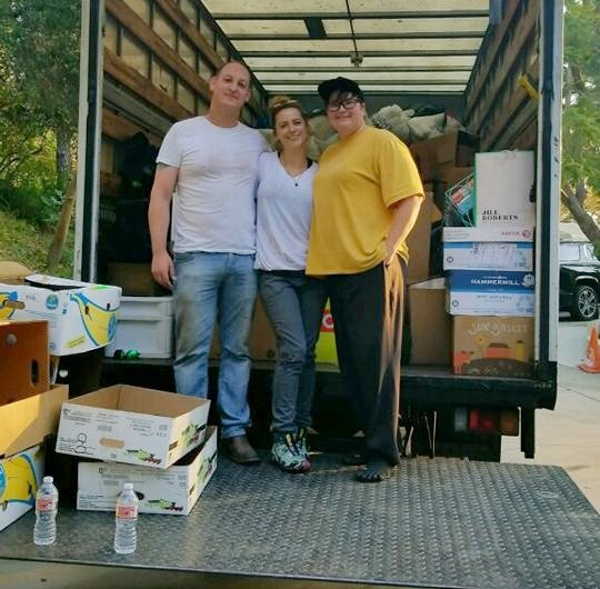 Bryon Smith, Leslie Borchard and Jennifer Crandell loading supplies bound for Ventura County fire victims