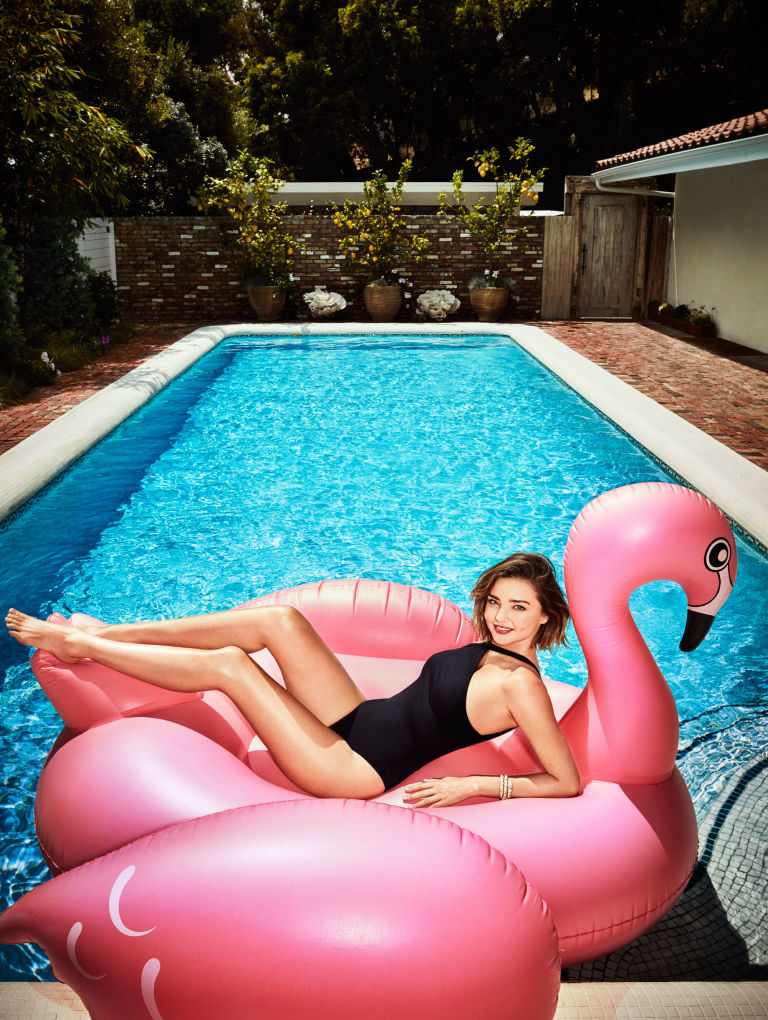 Kerr masters the sexy swimwear pose on a The Original Giant Flamingo inflatable flamingo. Hermès swimsuit, $510, hermes.com; Bulgari bracelet, $68,000, 800-BULGARI.  Douglas Friedman