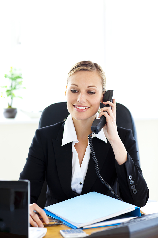 Professional woman smiling and talking on the phone