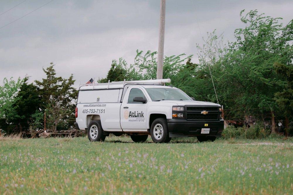 AtLink-service-truck-working-near-a-power-line.jpg