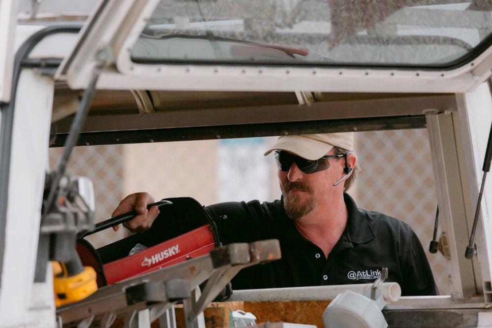 An-AtLink-technician-retrieving-tools-from-his-truck.jpg