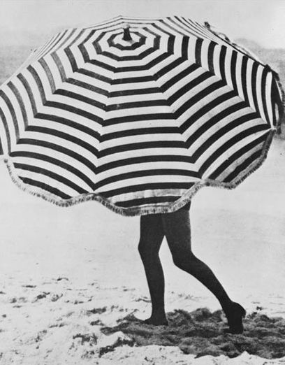 UMBRELLAS   - Used to shade oneself from rain or sunshine nothing looks more welcoming, on the beach or skipping through puddles, then stripes!