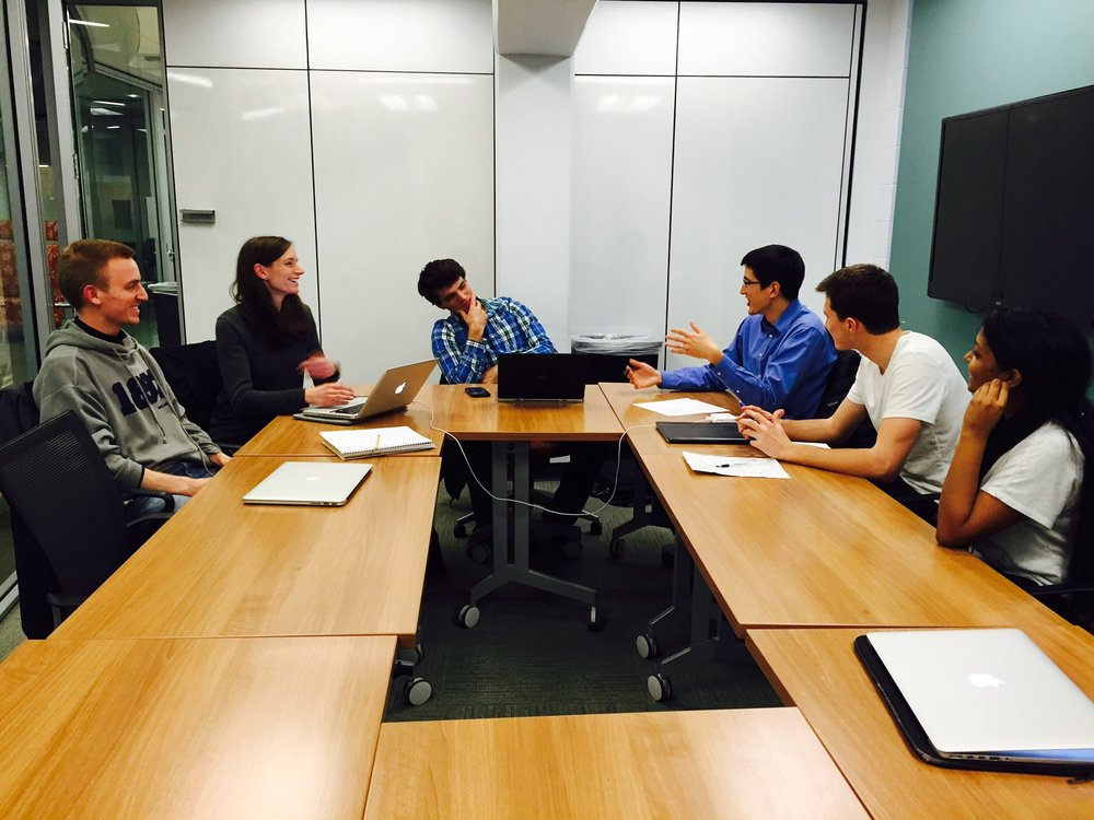 Students and staff at Duke University discuss carbon offset project development strategies.