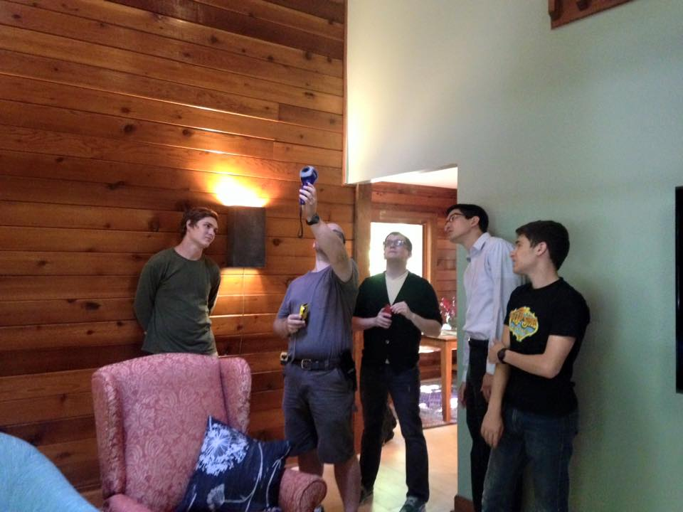 Students and staff observe a home energy audit