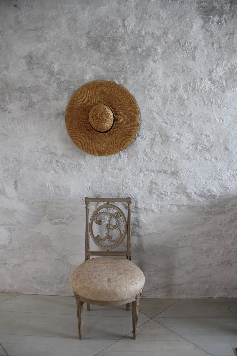 A chair and hat in the Oak Spring Garden Library.