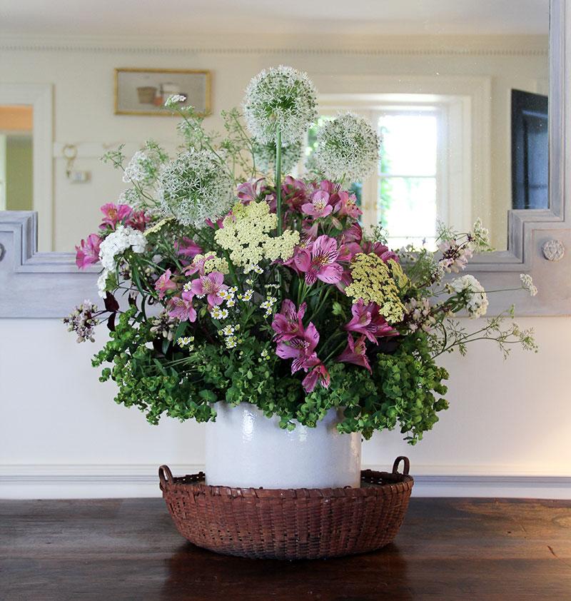 A ceramic pot containing a floral arrangement at Oak Spring.