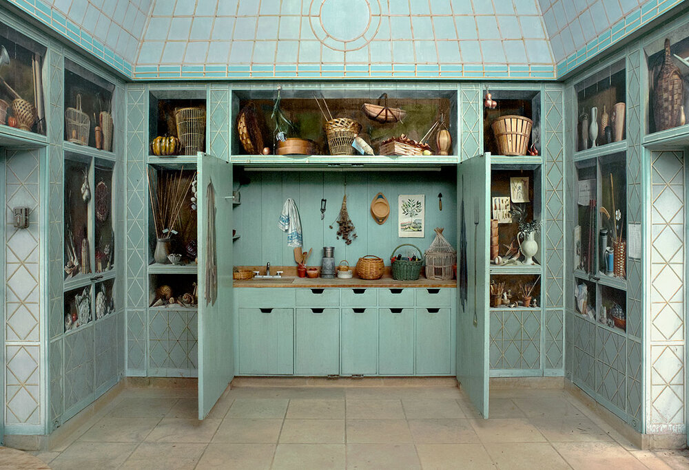 Lining the storage cabinets of the Oak Spring greenhouse is a charming trompe l'oeil mural by the famous French artist, Fernand Renard. Amid the landscaping tools and watering cans, Renard has included careful replications of Bunny's signature personal items, including her gardening hat, coat and letters.