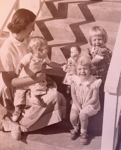 In the 1950s no one was talking about gender variance. I'm the toddler sitting on my mother's lap, reaching for my sister's doll.