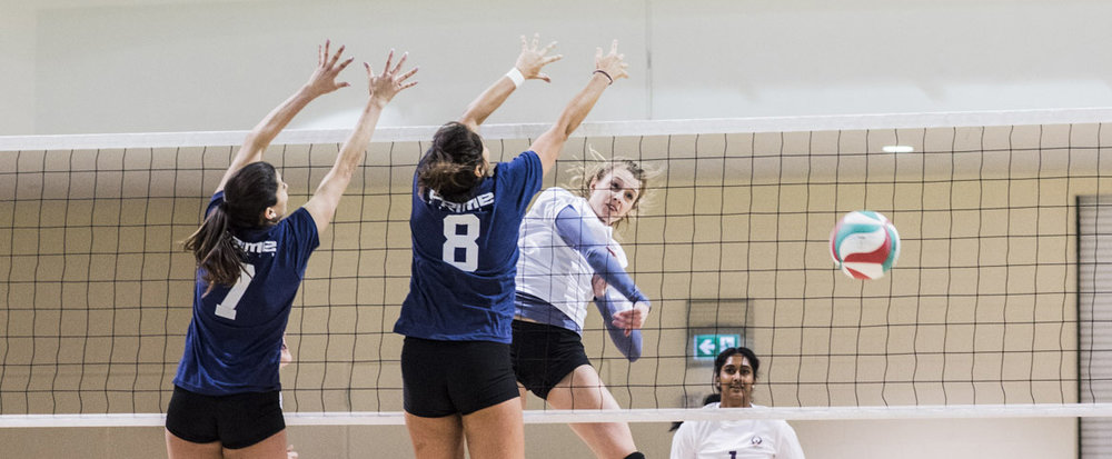 Ashley Simac, former member of the Canadian National Team, hammers a ball past the block at a Challenger Series Tournament.