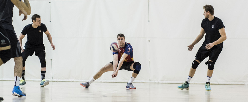 Former professional athlete Aaron Nusbaum digs a hard ball during a Challenger Series Tournament at the Toronto Pan Am Sports Centre