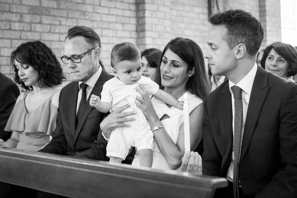 baby looking at christening candle.jpg