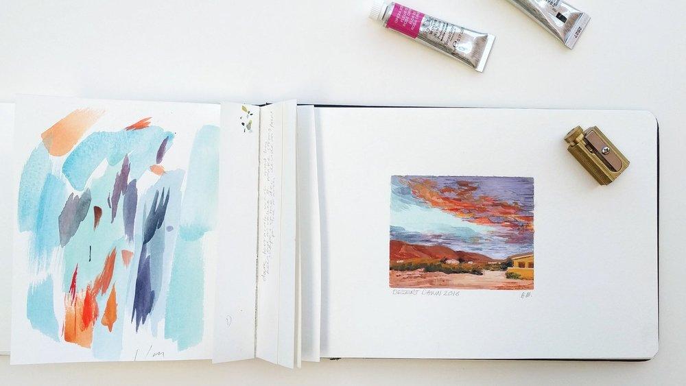 Miniature plein air watercolour painting of sunrise over the desert