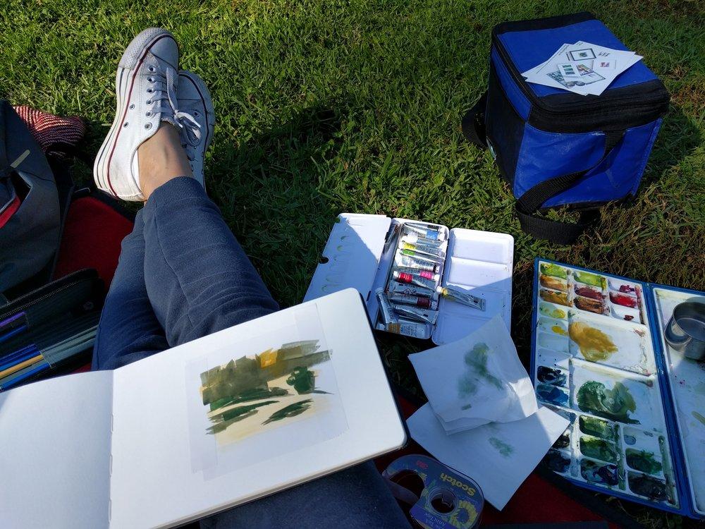 Artist Amanda Mears creating small plein air watercolour landscape painting of fall colour in autumn garden