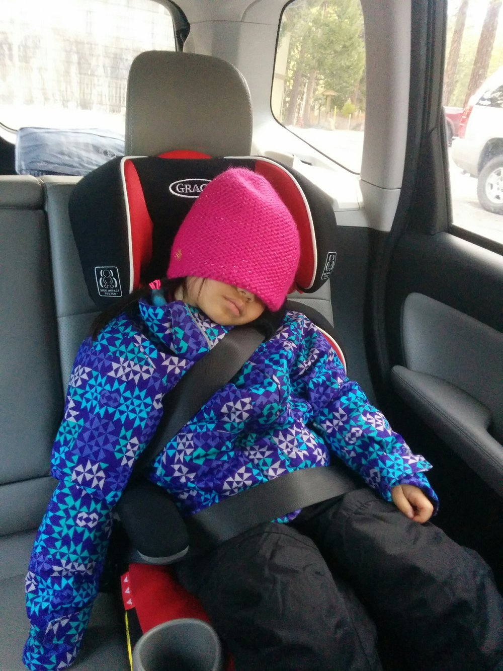 The ride home for Kelly usually means a nap in the car!