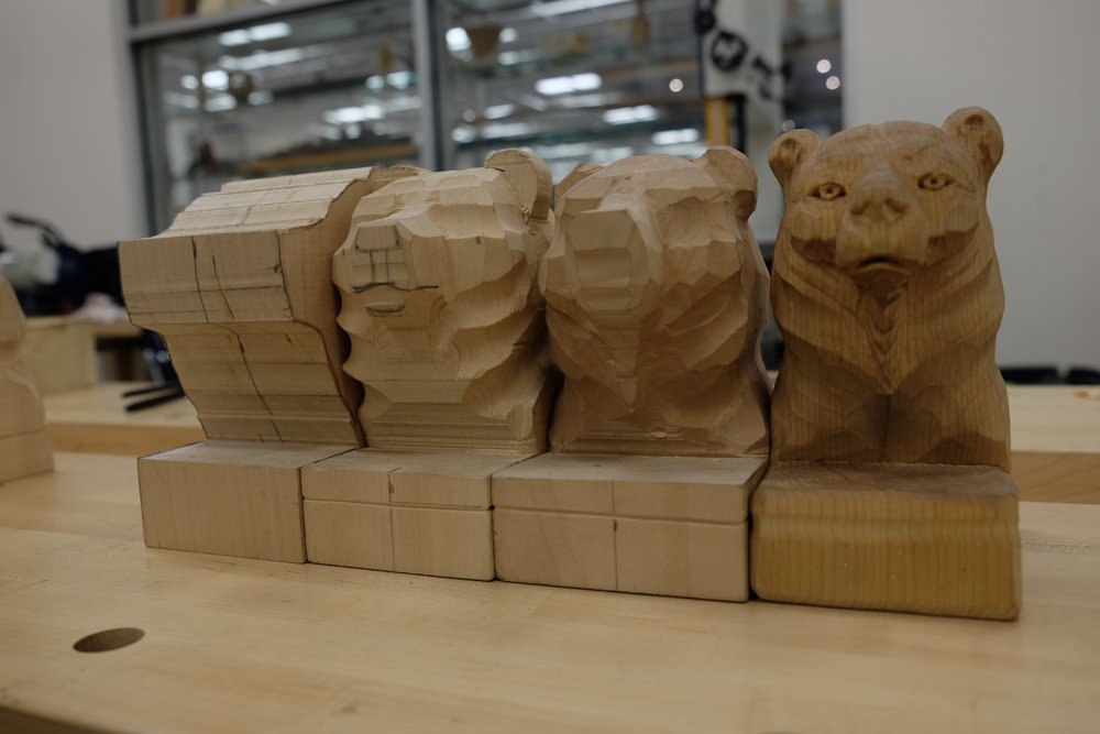 The progression of the bear head carving