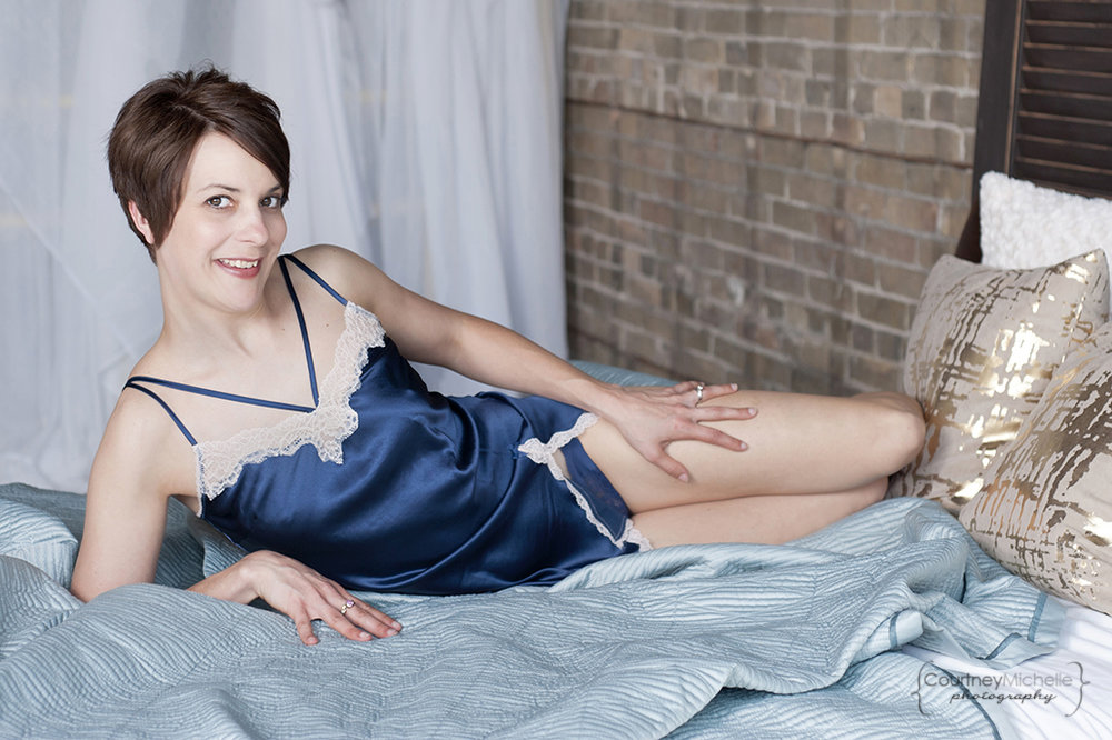 woman-in-blue-lingerie-on-bed-boudoir-photography-by-chicago-boudoir-photographer-courtney-laper.jpg