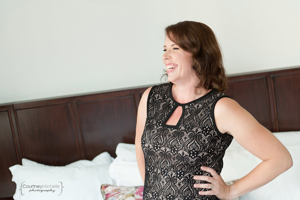 woman-in-lacy-black-dress-laughing-on-bed-chicago-boudoir-photography-by-courtney-laper.jpg
