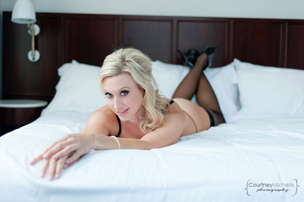 woman-in-lingerie-and-pearls-and-heels-laying-on-bed-chicago-boudoir-photography-by-courtney-laper.jpg