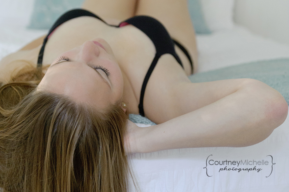 woman-in-lingerie-laying-down-on-back-close-up-of-eyelashes-chicago-boudoir-photography-by-courtney-laper.jpg