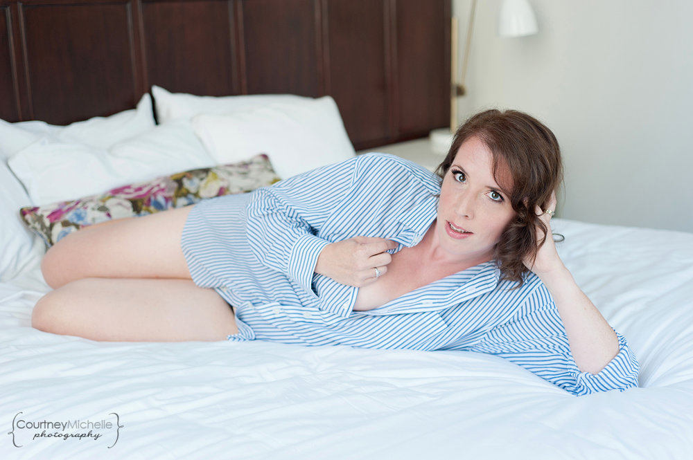 woman-in-mens-dress-shirt-on-bed-chicago-boudoir-photography-by-courtney-laper.jpg