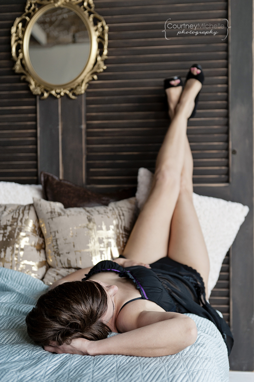 woman-laying-down-legs-up-on-headboard-chicago-boudoir-photography-by-courtney-laper.jpg